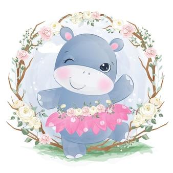 Adorável bebê hipopótamo brincando no jardim
