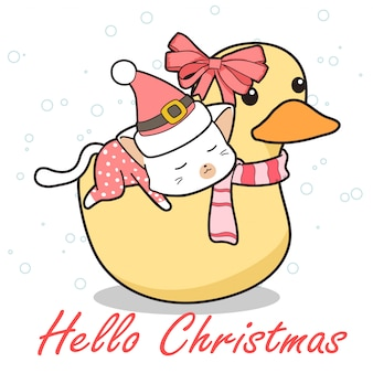 Adorável gato está montando o pato no dia de natal