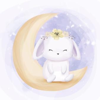 Adorável pequeno coelho sente-se na lua