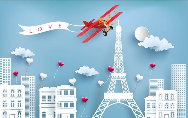 Aeronaves carregando bandeiras de amor voando sobre a cidade e as torres eiffel.