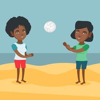 Africano-americanas mulheres jogando vôlei de praia.