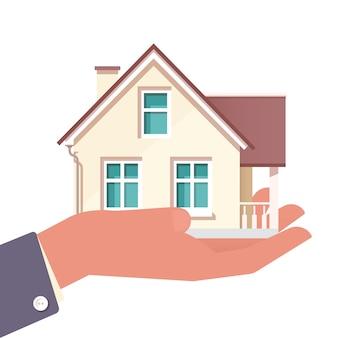 Agente de mão com casa na palma da mão