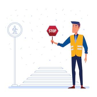 Agente de segurança do tráfego com sinal da parada na frente da faixa de travessia.
