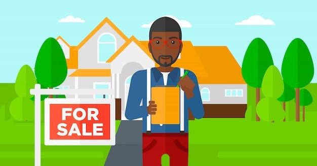 Agente imobiliário assinar contrato.