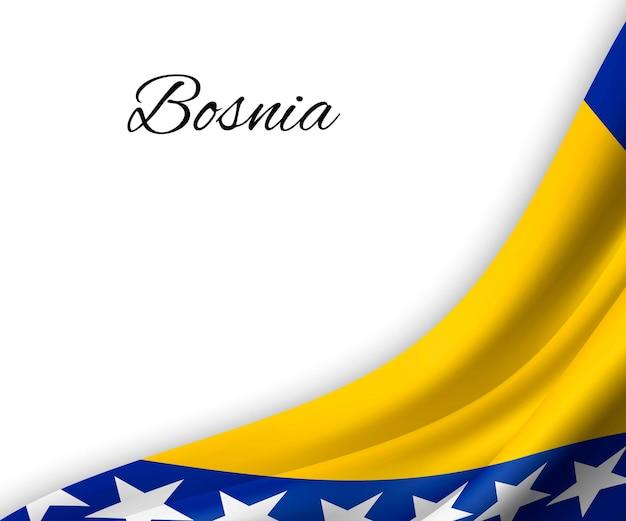 Agitando a bandeira da bósnia em fundo branco.