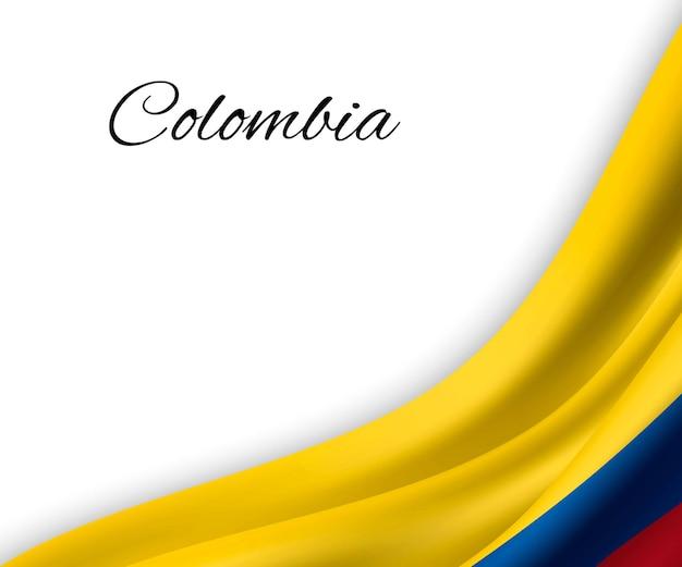 Agitando a bandeira da colômbia em fundo branco.