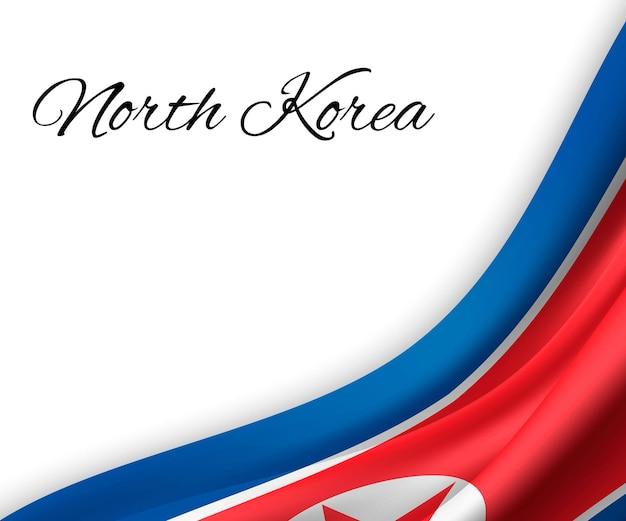 Agitando a bandeira da coreia do norte em fundo branco.