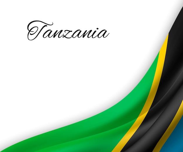Agitando a bandeira da tanzânia em fundo branco.