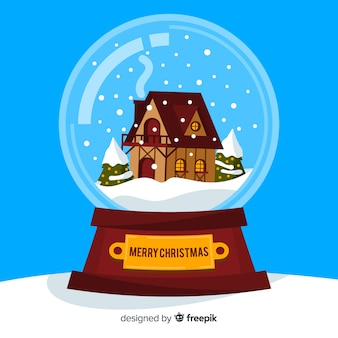 Agitando o globo com neve e casa