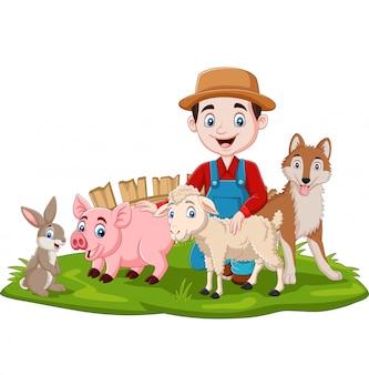 Agricultor com animais de fazenda na grama