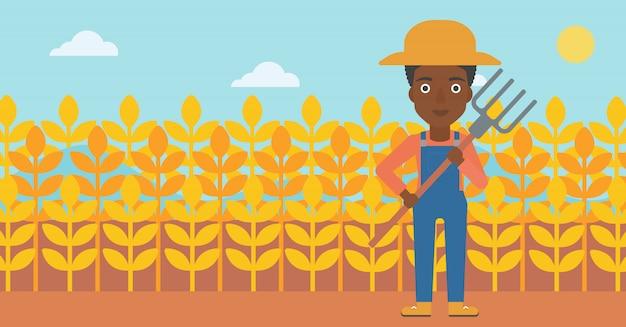 Agricultor com forcado