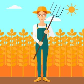 Agricultor com forcado.
