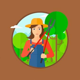 Agricultor com poda no jardim.