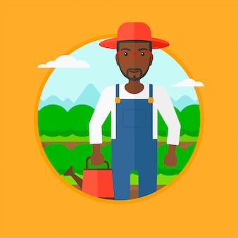 Agricultor com regador no campo de repolho.