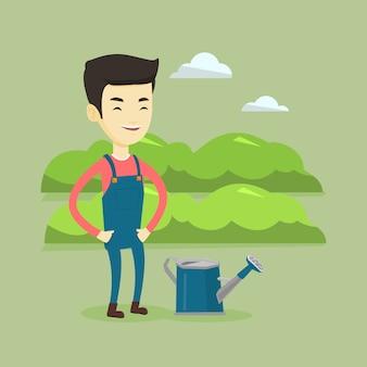 Agricultor com regador no campo.