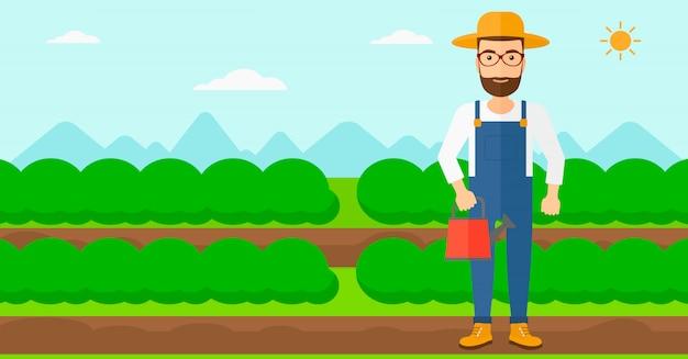 Agricultor com regador.