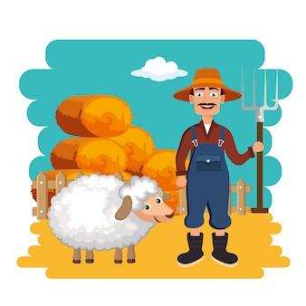 Agricultor em pé ao lado de fardos de feno e ovelhas