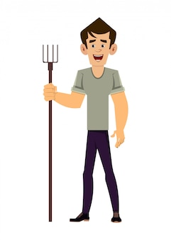 Agricultor em pé com segurando o garfo agrícola