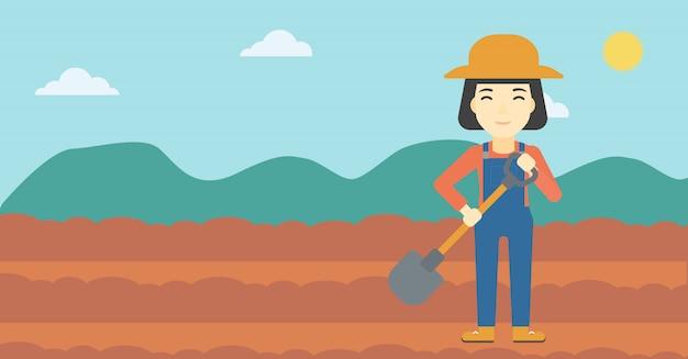 Agricultor feminino com pá
