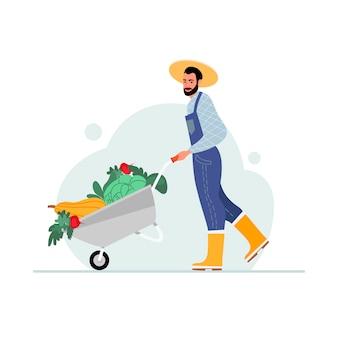 Agricultor masculino com um carrinho de legumes. o conceito de comida orgânica saudável