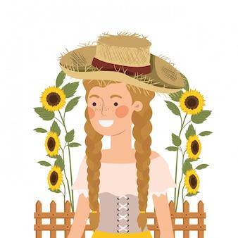 Agricultor mulher com chapéu de palha e girassóis