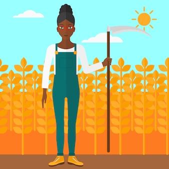 Agricultor no campo com foice.
