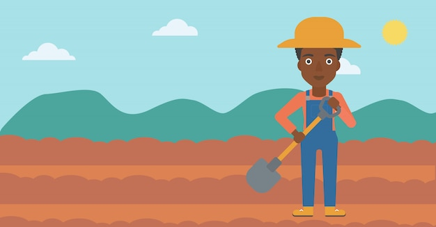 Agricultor no campo com pá