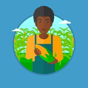 Agricultor segurando a ilustração vetorial de milho.
