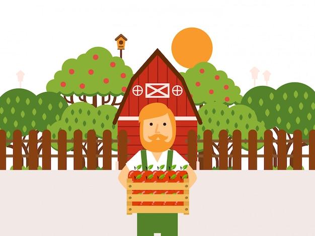 Agricultor segurando uma caixa de madeira de maçãs no pomar