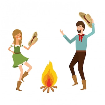 Agricultores casal dançando com chapéu de palha e fogueira
