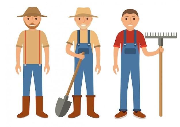 Agricultores com um ancinho e uma pá.