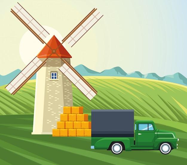 Agricultura moinho de vento caminhão fardos de feno na grama