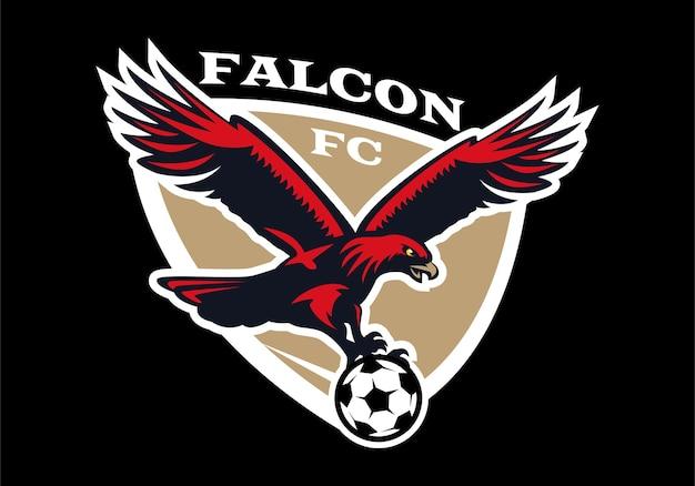 Águia segura bola de futebol. logotipo do emblema de futebol