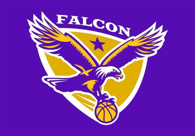 Águia segura uma bola de basquete. logotipo do emblema de basquete