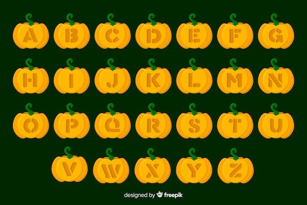 Alfabeto de abóbora de halloween em fundo verde