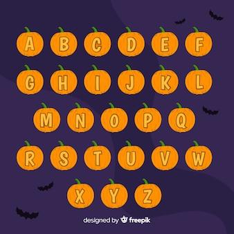 Alfabeto de abóbora de halloween em uma noite com morcegos
