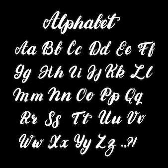 Alfabeto de caligrafia escrita em letras minúsculas e maiúsculas