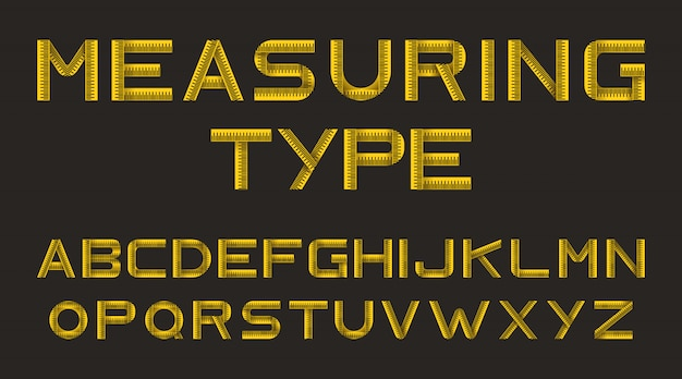 Alfabeto de fita métrica amarela