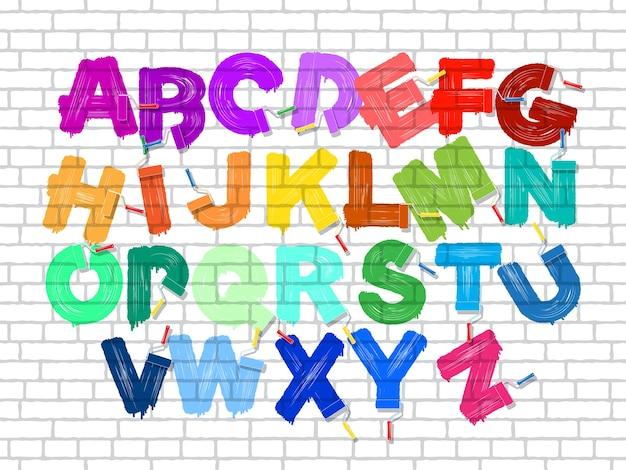 Alfabeto de graffiti com pincel de rolo colorido no fundo da parede de tijolos antigos