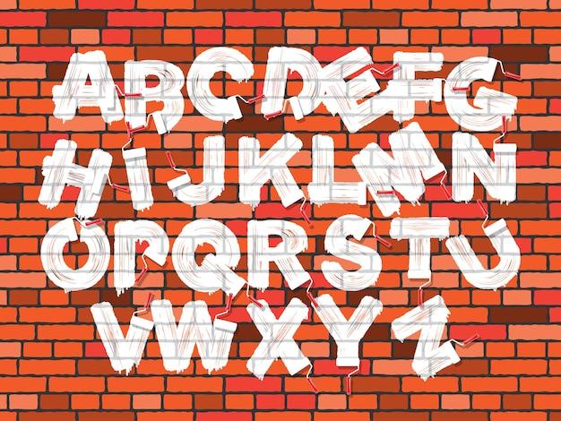 Alfabeto de graffiti de escova de rolo de cor branca no fundo da parede de tijolo vermelho. conjunto de fontes