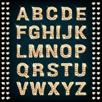 Alfabeto de ouro com diamantes em forma de coração.