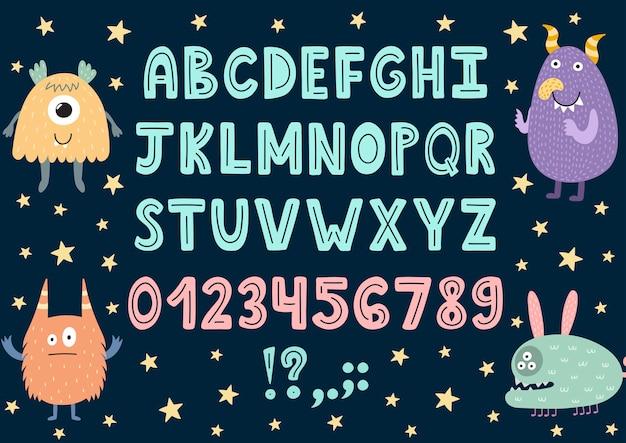 Alfabeto desenhado de mão com monstros bonitinho