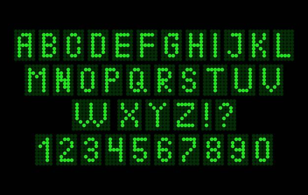 Alfabeto e números de luz em um fundo preto.