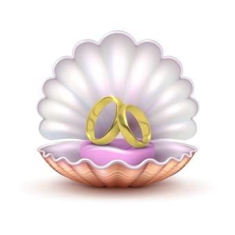 Alianças de casamento douradas realísticas no seashell isolado. para casar com o conceito de vetor