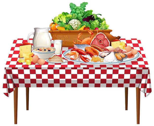 Alimentos frescos ou grupos de alimentos na mesa com toalha de mesa quadriculada