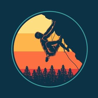 Alpinista ao pôr do sol