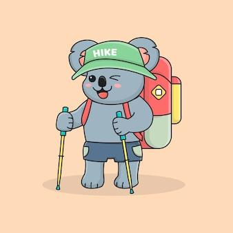 Alpinista de coala fofo com vara de trekking, chapéu e mochila