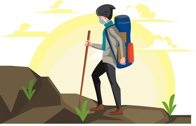 Alpinista está escalando uma montanha sozinho