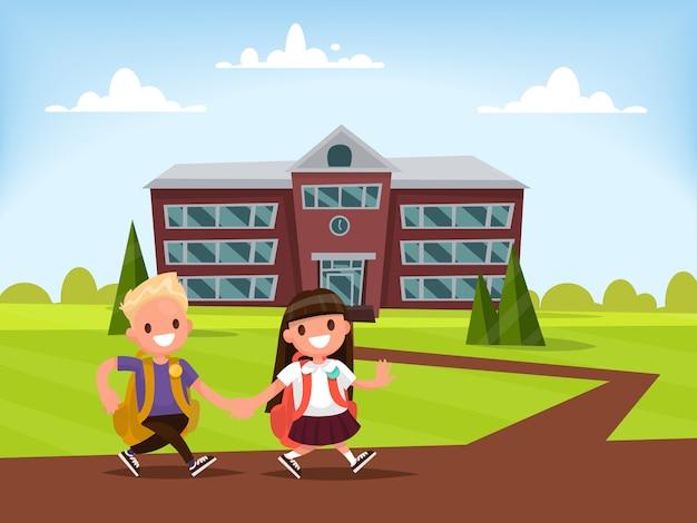Alunos do ensino fundamental. estudante e colegial andam juntos de mãos dadas para a escola.