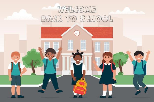 Alunos meninas e meninos perto da escola construindo faixa de crianças felizes de volta à escola